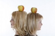 Two women with an apple on th...