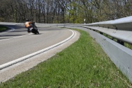 Motorcyclist in a curve on a ...