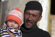 Kirghiz man with baby, Pamir,...