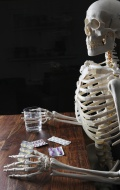 Skeleton holding tablets and ...