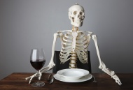 Skeleton sitting with a glass...