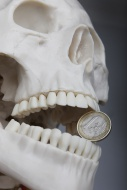 Skeleton with a euro-coin bet...