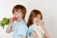 Boy eating radishes, girl rej...