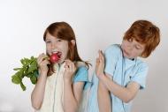 Girl eating radishes, boy rej...