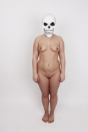 Woman, naked, wearing a skull...