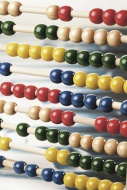 Close up of abacus on white b...