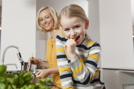 Mother with daughter eating c...