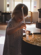 Little girl with candle in a ...