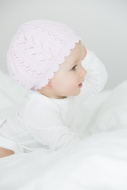 Baby girl wearing cap