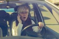 Frightened senior woman in ca...