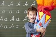 Happy boy with school cone at...