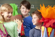 Happy pupils with school cone...