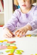 Little girl learning alphabet...