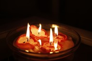 Burning candles in a bowl