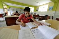Peru, Brena, pupils doing hom...
