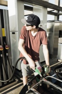 Teenager at gas station refue...