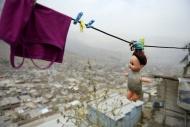 Peru, Lima, Huaycan, doll han...
