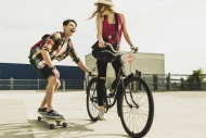 Happy young couple with bicyc...