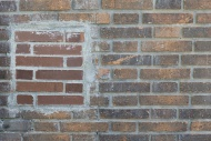 Repaired old brick wall