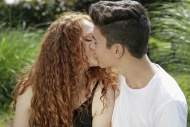 Kissing teenage couple