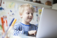 Portrait of little boy using ...