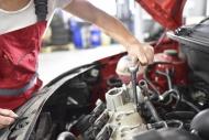 Car mechanic working in repai...