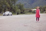 Little girl hitchhiking