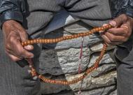 Nepal, Khumbu, man holding pr...
