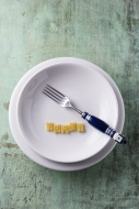Pasta letters and a fork on p...