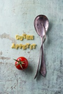 Pasta letters, tomato, fork a...