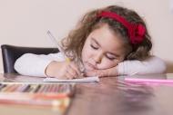 Portrait of drawing little girl