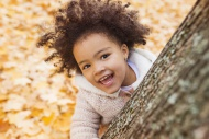 Little girl playing in autumn...