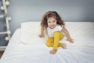 Smiling little girl sitting o...