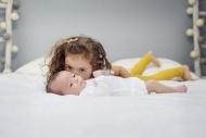 Big sister kissing newborn ly...