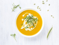 Bowl of carrot pumpkin soup w...