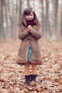 Young girl, brown coat in par...