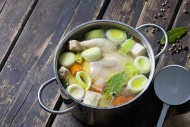 Cooking pot with raw corn-fed...