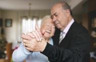 Hands of senior couple dancin...