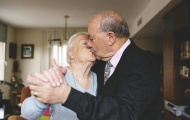 Senior couple kissing and dan...