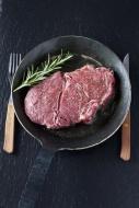 Raw rib eye steak with rosmar...