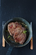 Rib eye steak with rosmary in...