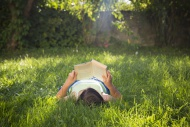Girl reading book on a meadow