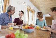 Happy family having breakfast...