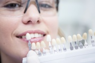Woman at the dentist choosing...