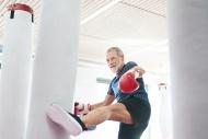 Fit senior man in boxing glov...