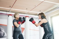 Two fit senior women boxing i...