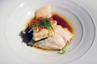 Steamed wild sea-bass with gi...