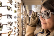 Woman Trying Sunglasses in Shop