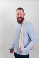 Man with a beard screams Yeah