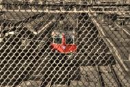Train behind a fence in Locar...